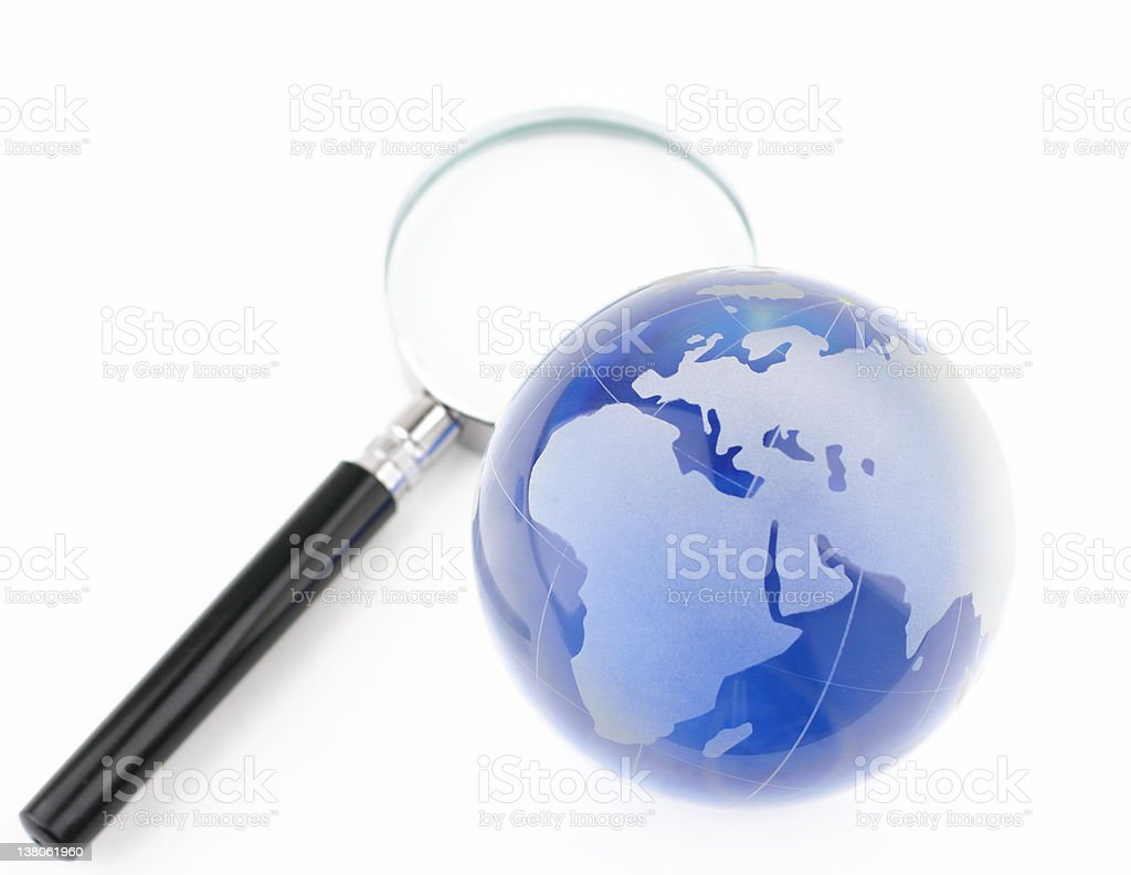 Globe and magnifier royalty-free stock photo