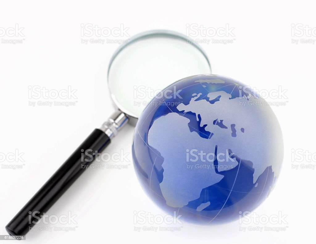 Globe and magnifier stock photo