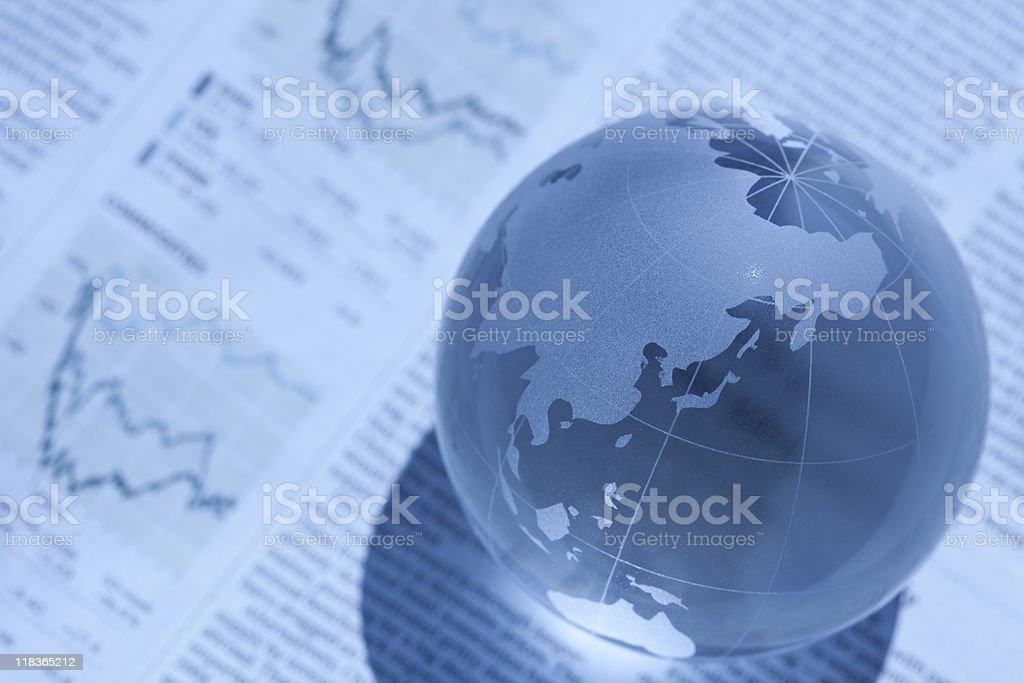 Globe and newspaper stock photo
