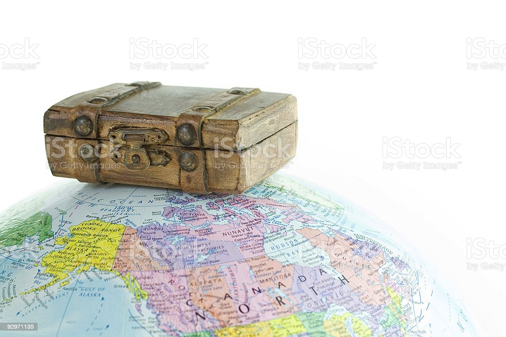 Globe and Old brown suitcase stock photo