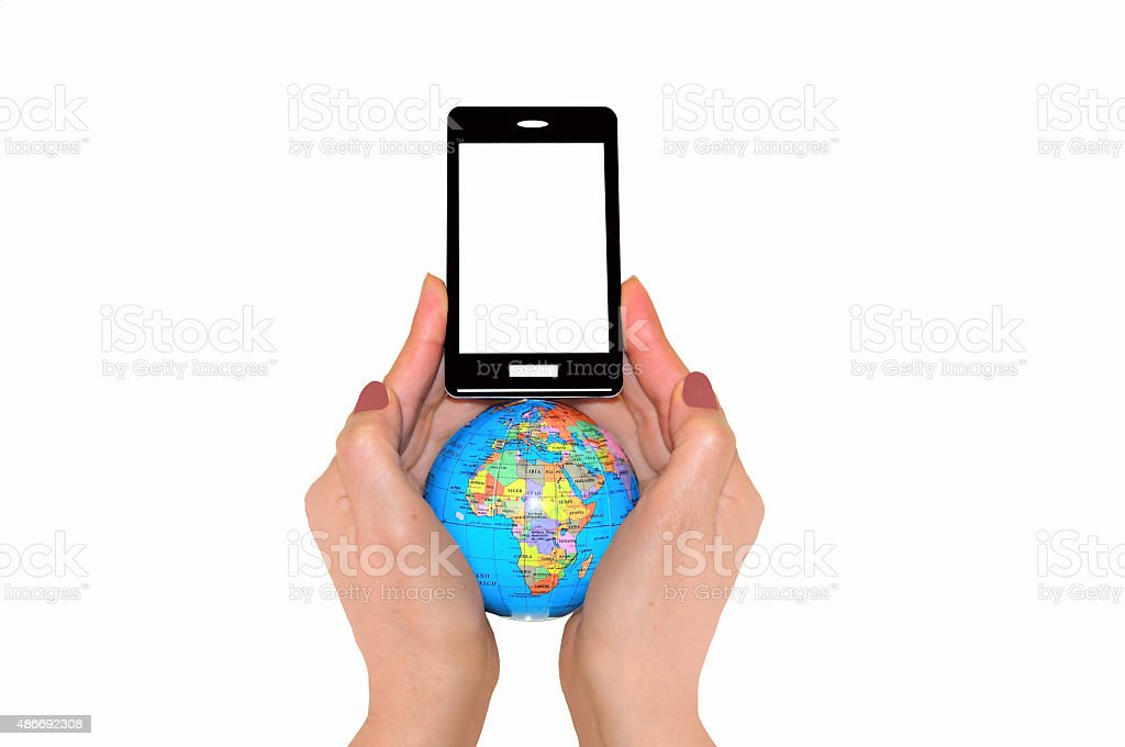 Globe and phone in two hands stock photo