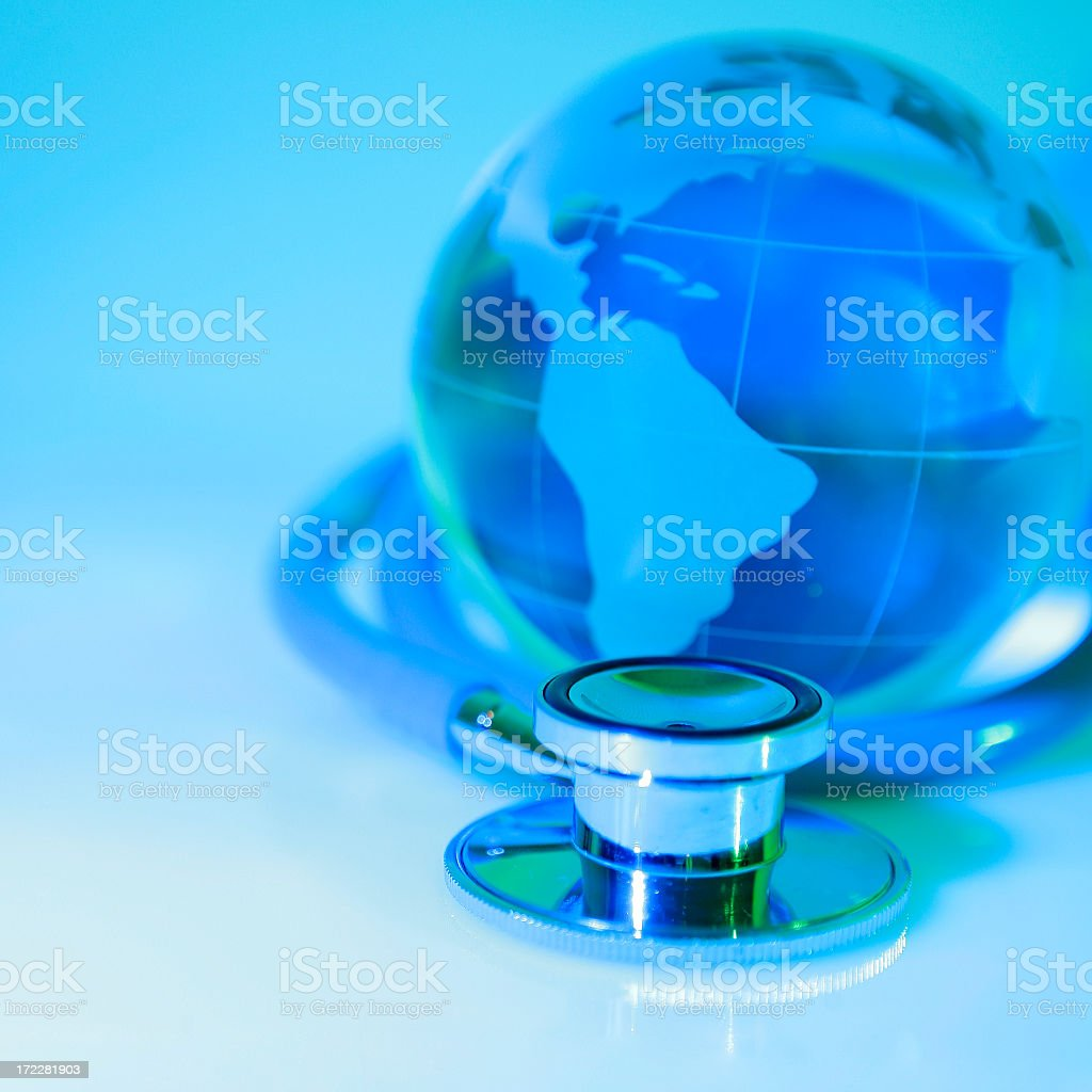 Globe and stethoscope to convey global healthcare concept royalty-free stock photo