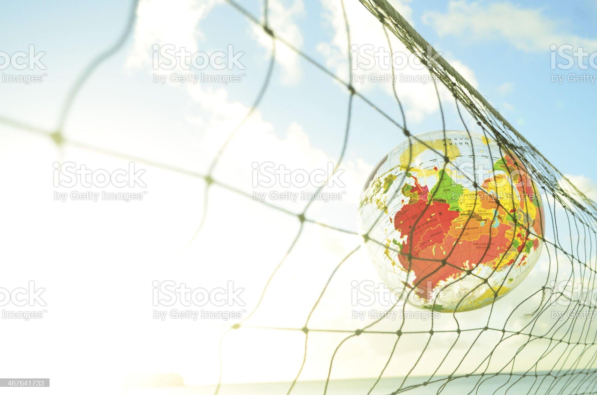globe and volleyball net royalty-free stock photo