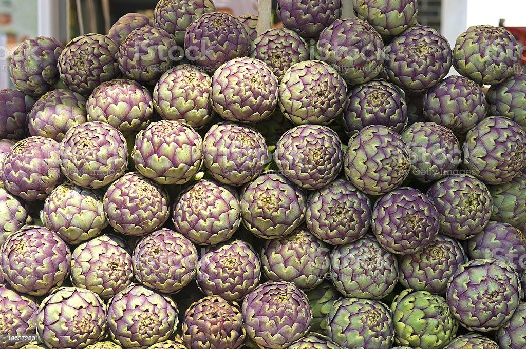 Globe artichokes in an Italian market. royalty-free stock photo
