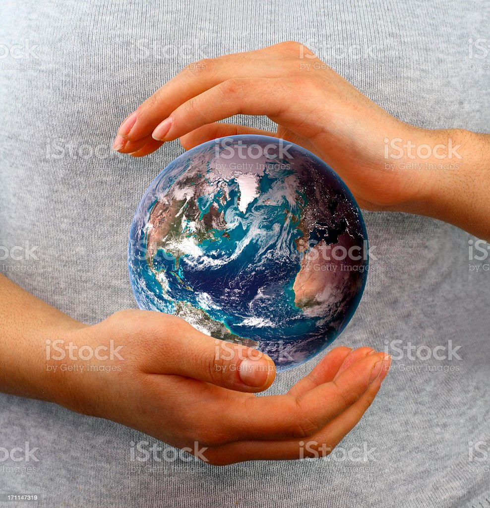 Globe between hands stock photo