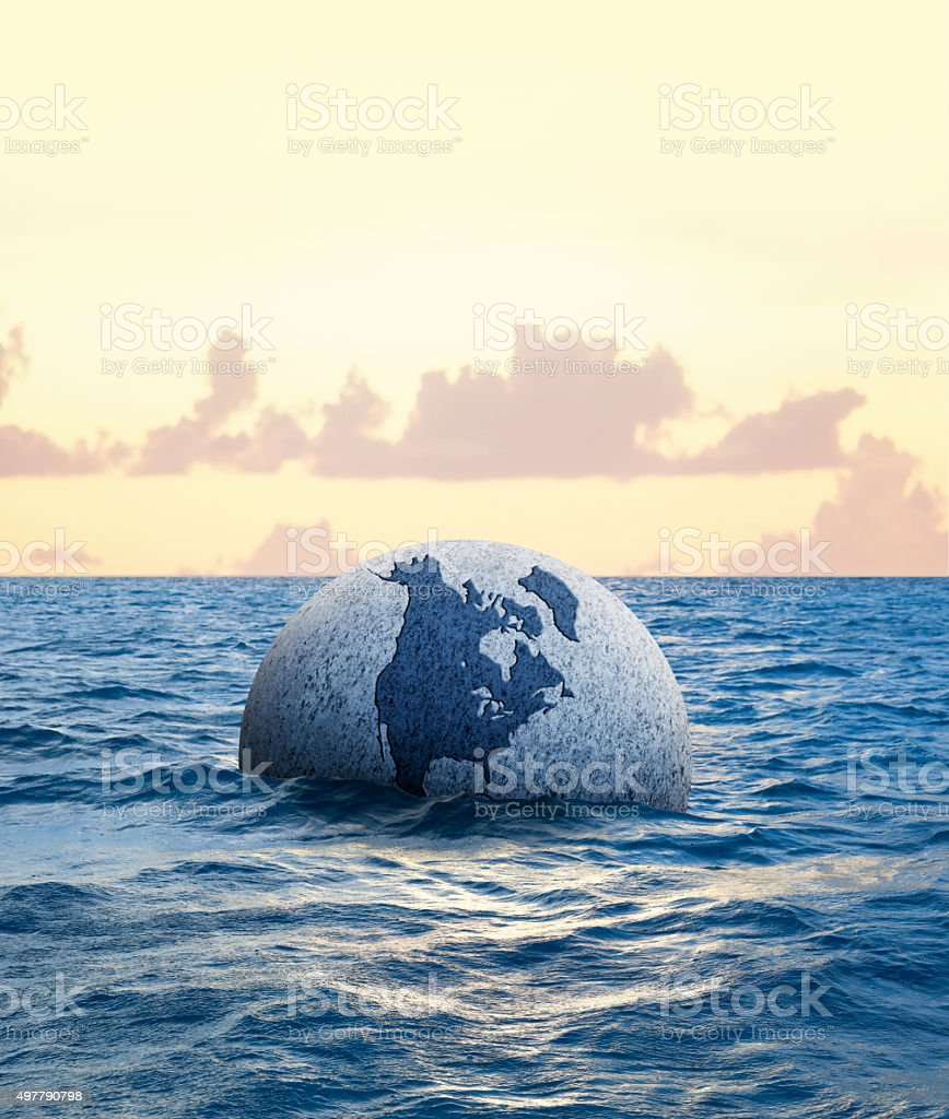 Globe Floating In The Ocean stock photo