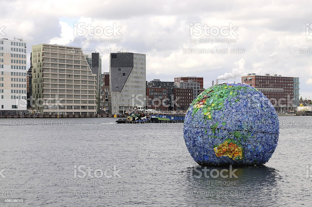 Globe from plastic bottles in Amsterdam royalty-free stock photo