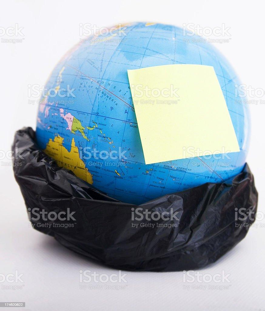 globe in garbage bag royalty-free stock photo