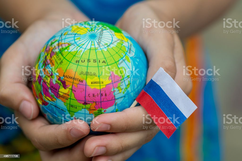 Globe in hand with the Russia flag stock photo