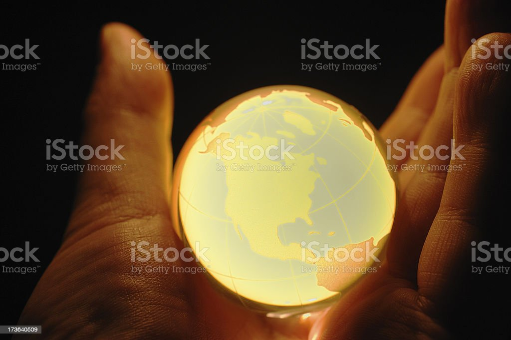 Globe in hands stock photo