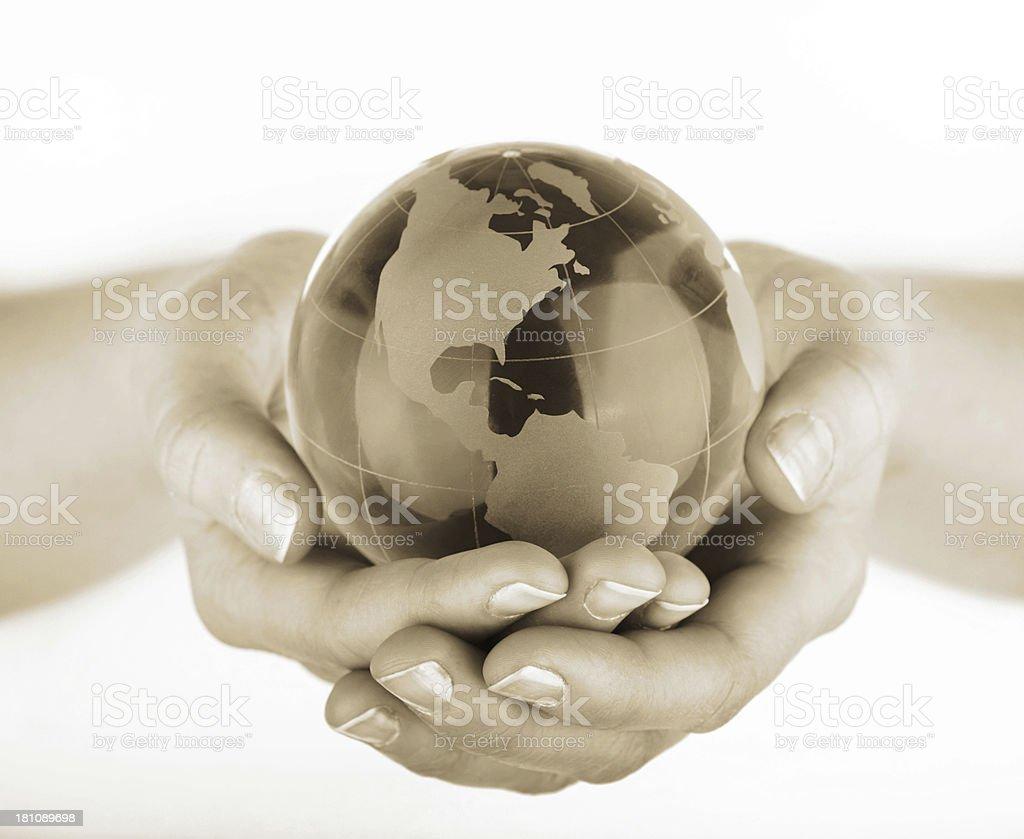 Globe in hands stock photo