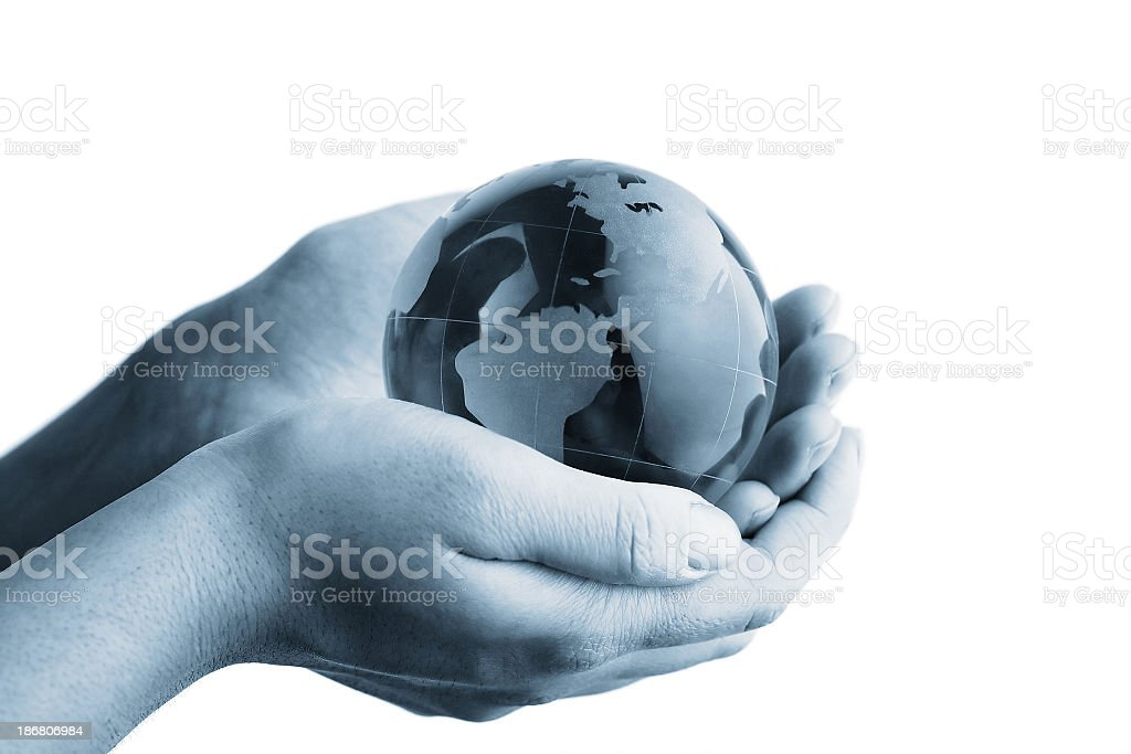 Globe in hands royalty-free stock photo