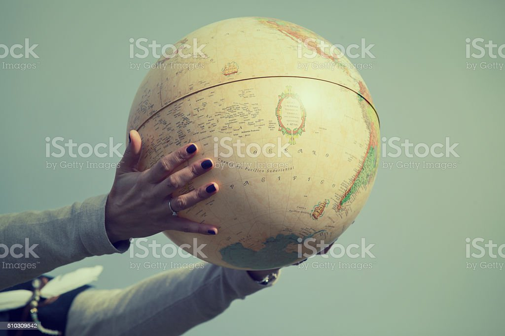 Globe in hands. Travel concept. stock photo