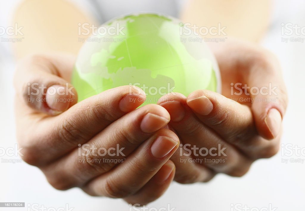 Globe in the palm royalty-free stock photo
