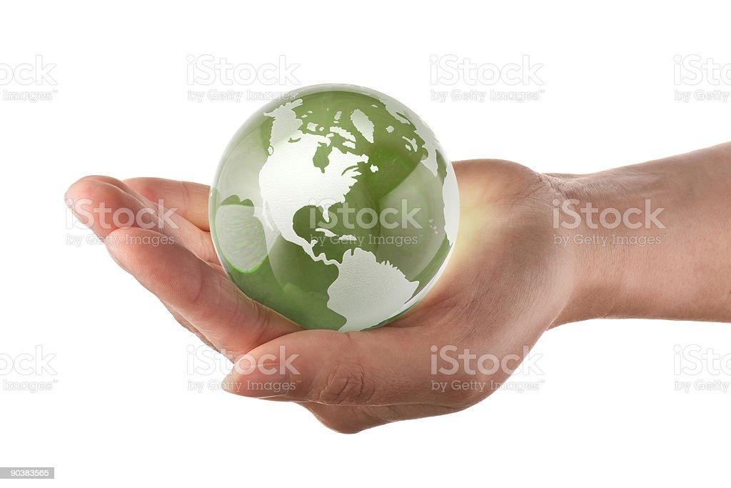 Глобус в womans руку Стоковые фото Стоковая фотография