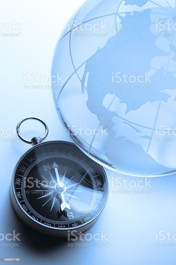 Globe Leaning On Top Of Compass royalty-free stock photo