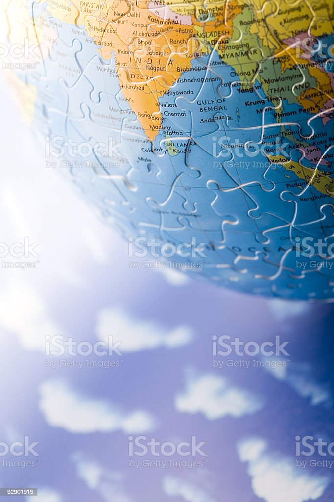 Globe made from puzzle stock photo
