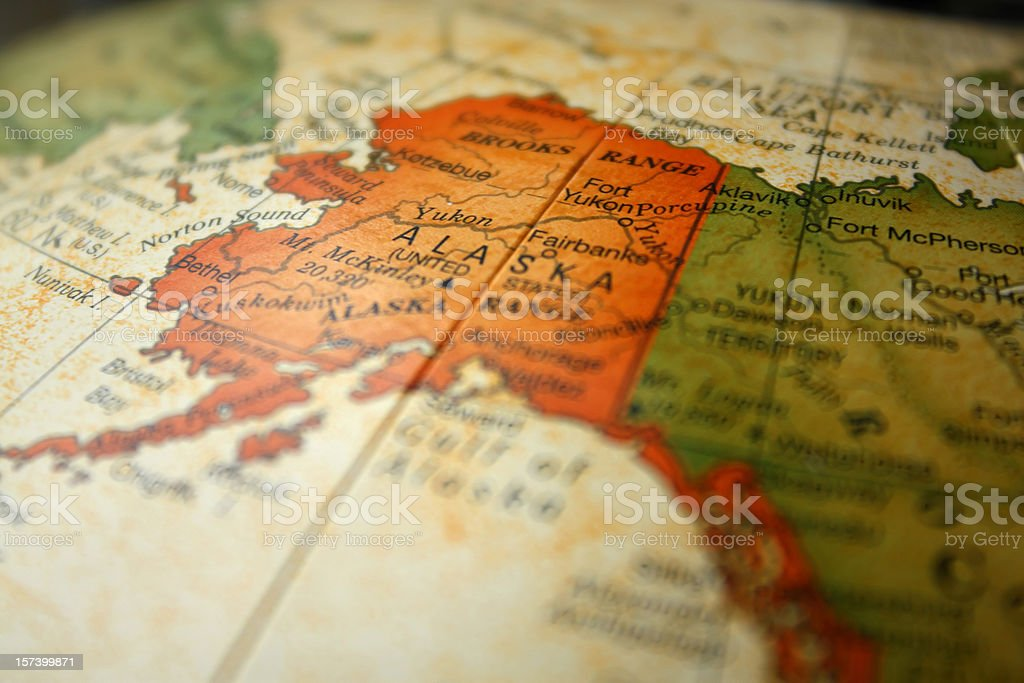 Globe map drawing focused on Alaska stock photo