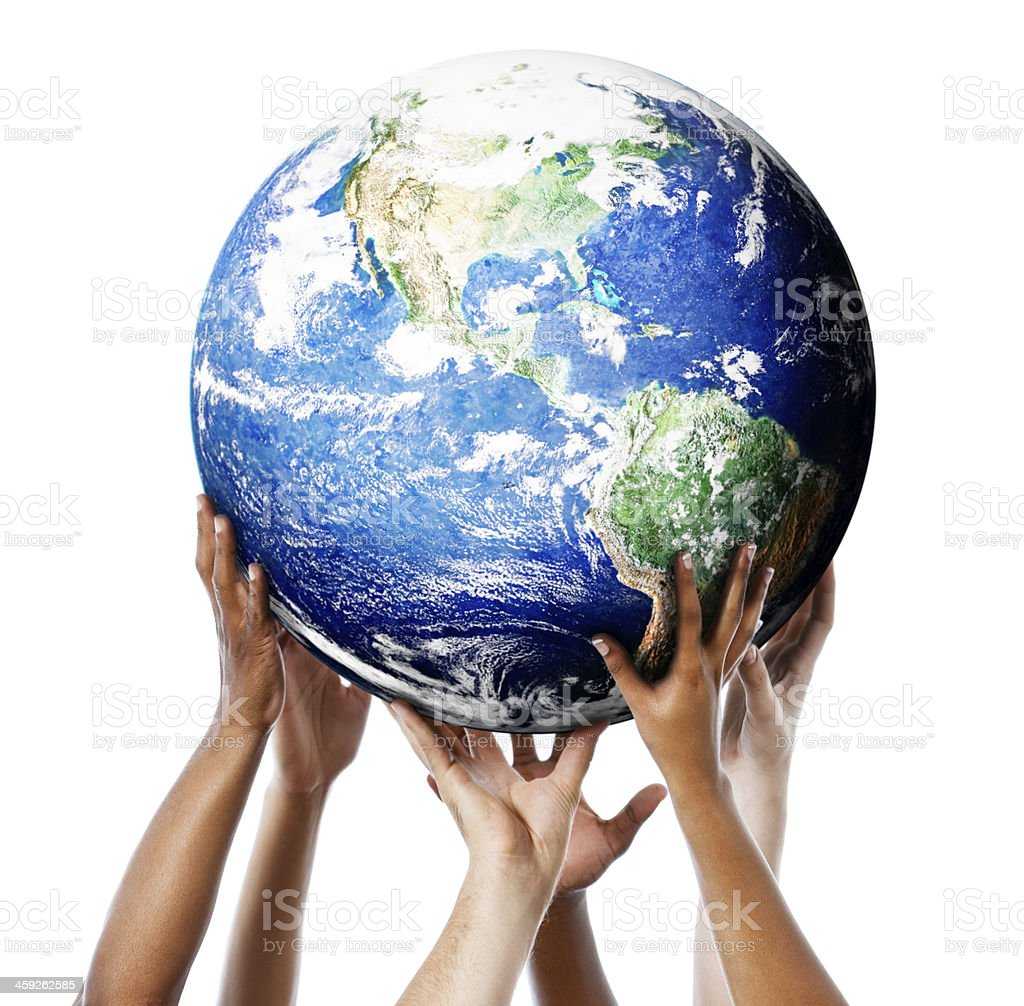 Globe of Earth being held up by multiple hands stock photo
