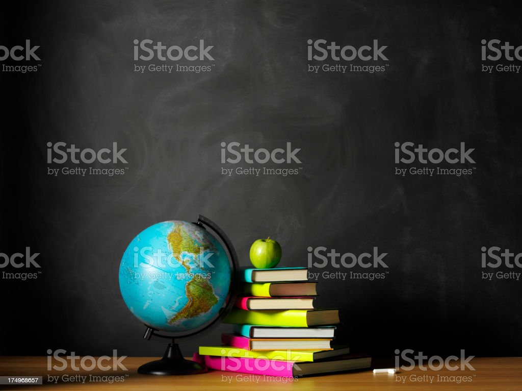 Globe of the World with a Green Apple and Books stock photo