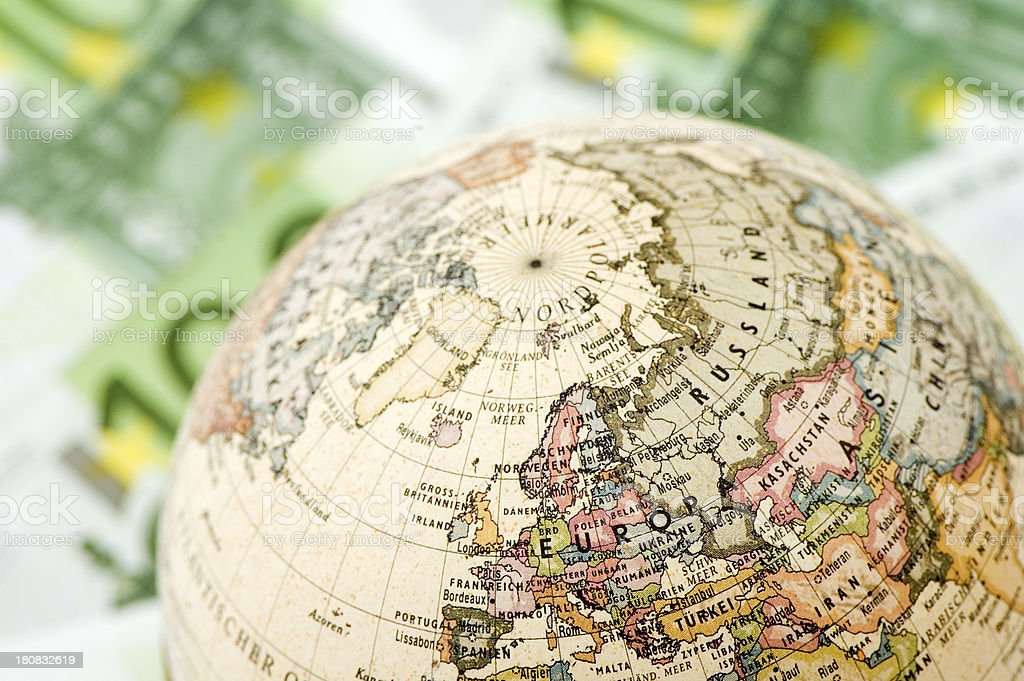 Globe on 100 euro banknote background. royalty-free stock photo
