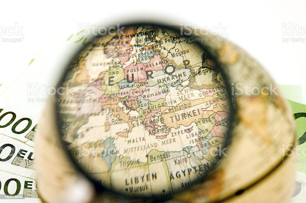 Globe on 100 euro banknote background. stock photo