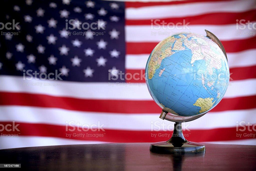globe on an American flag royalty-free stock photo