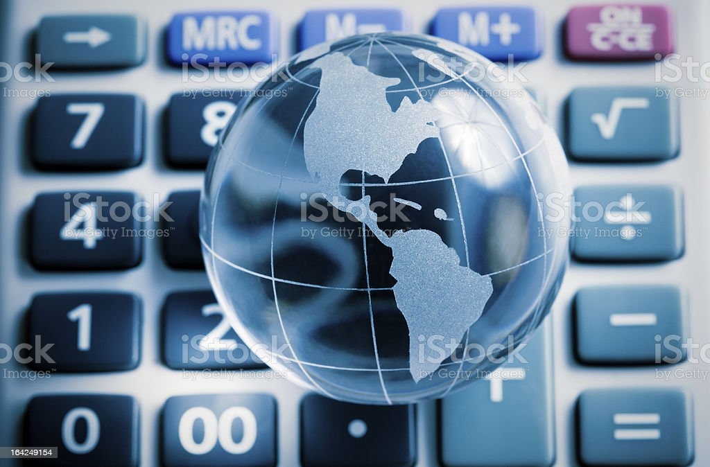 Globe on calculator, america map royalty-free stock photo