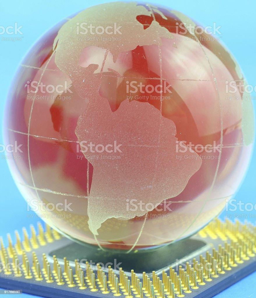 Globe on chip stock photo