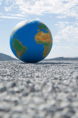 Globe on gravel outdoors