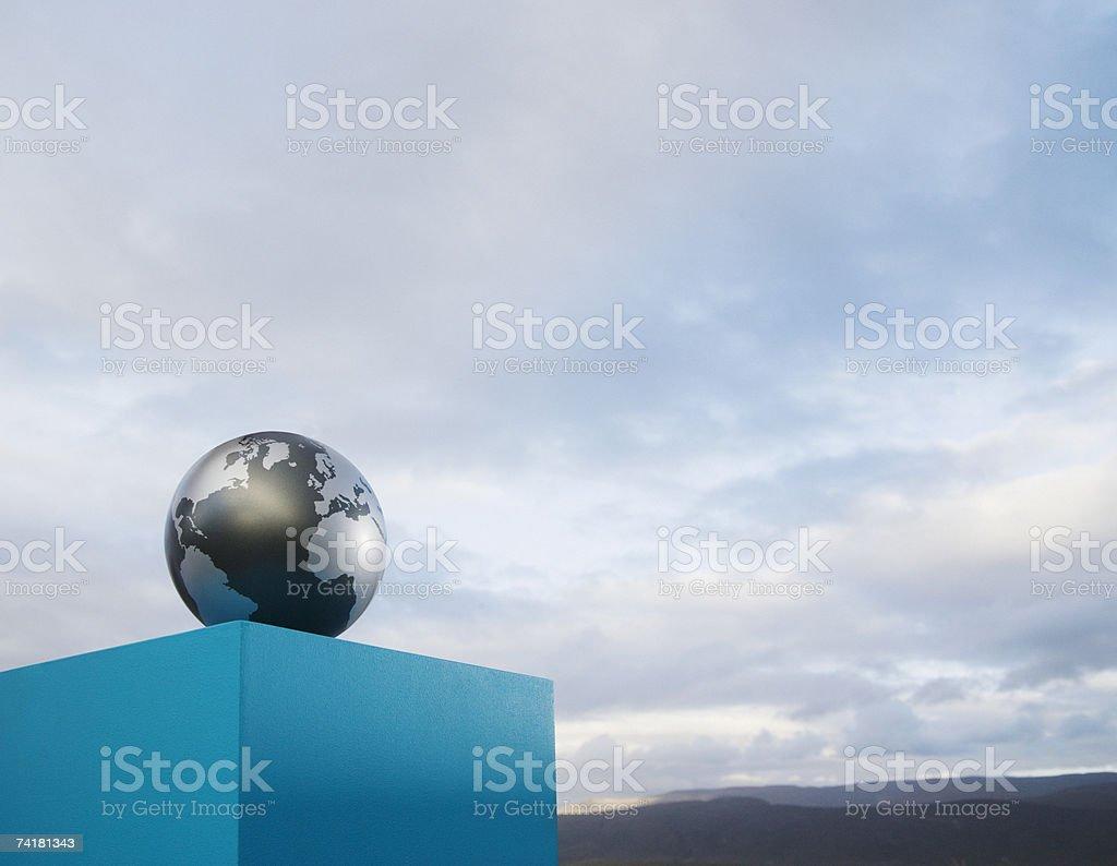Globe on pedestal outdoors royalty-free stock photo