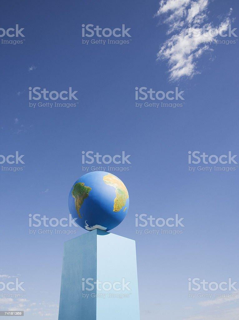 Globe on pedestal outdoors stock photo