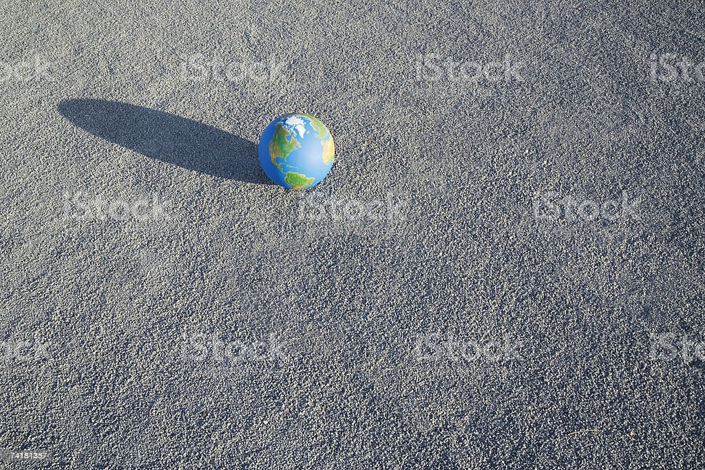 Globe on sand outdoors royalty-free stock photo