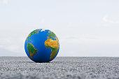 Globe on sand outdoors