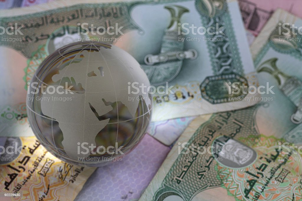 globe on uae currency dirham notes royalty-free stock photo