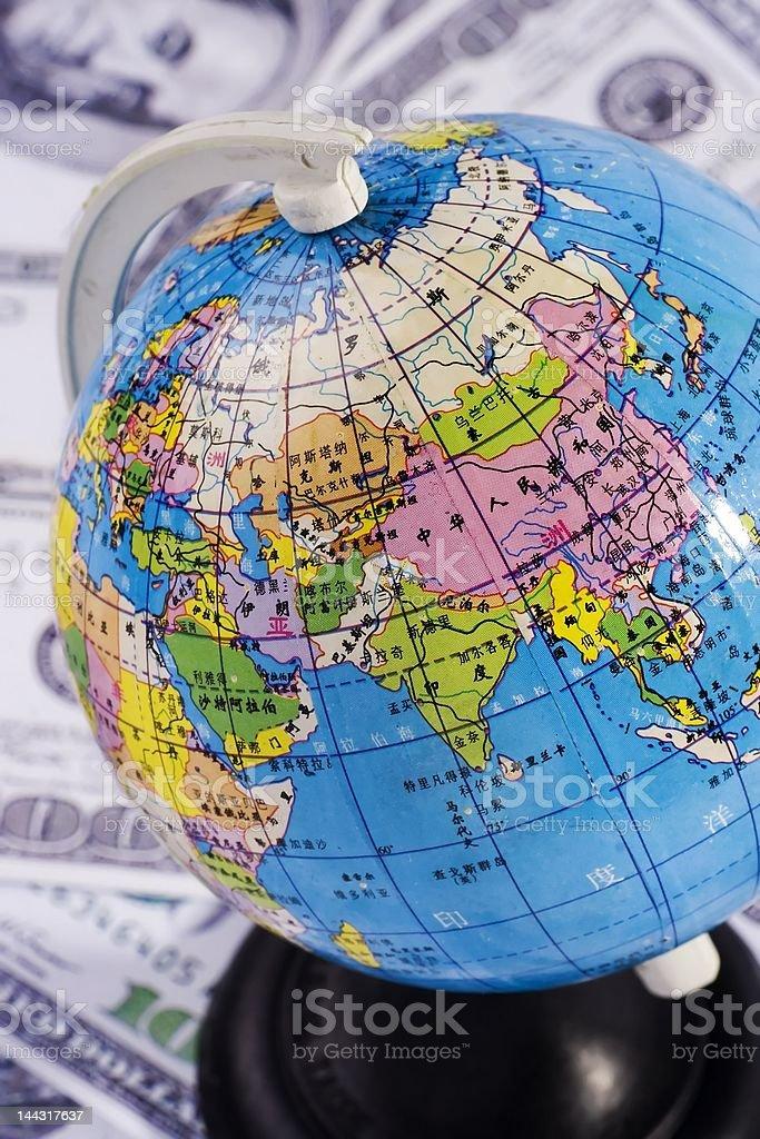 Globe Over Money royalty-free stock photo