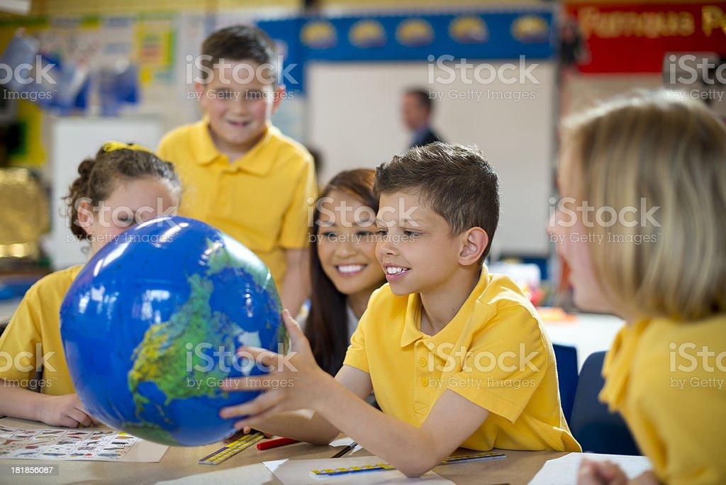 globe schoolchildren royalty-free stock photo