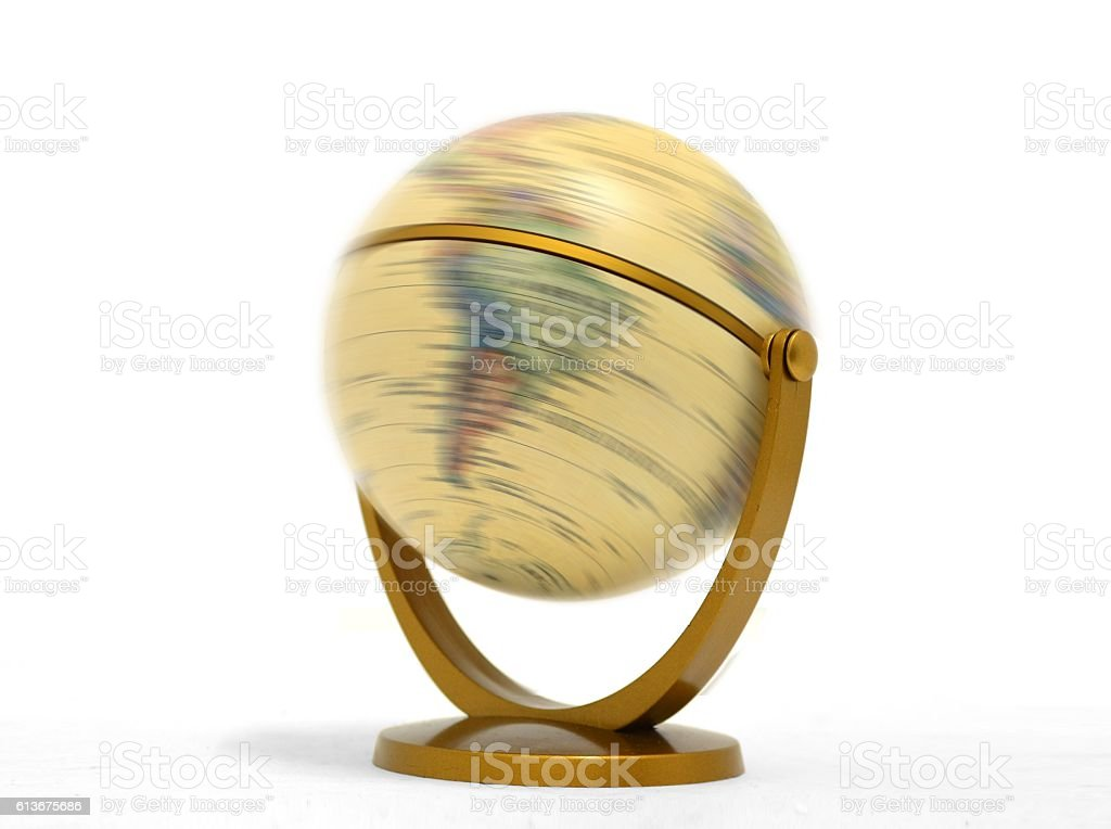 Globe spinning over white stock photo