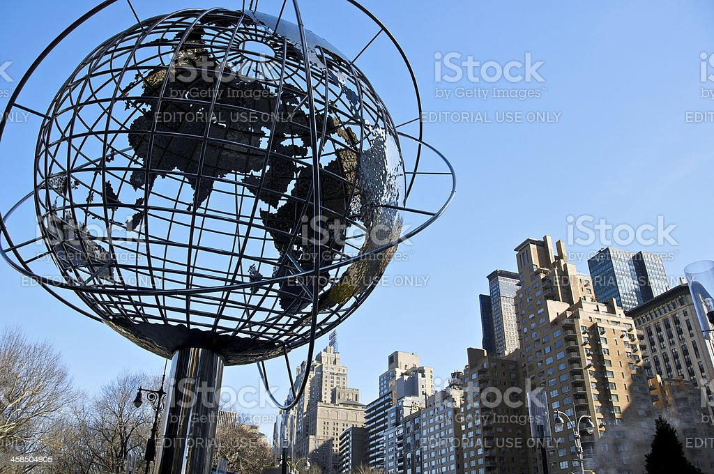 Globe structure at Columbus Circle with cityscape, NYC stock photo