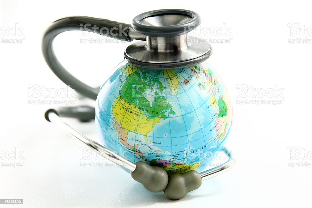 A globe with a stethoscope coiled around it royalty-free stock photo
