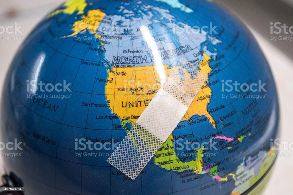 Globe with Bandaid/Plaster Over U.S.A/North America royalty-free stock photo