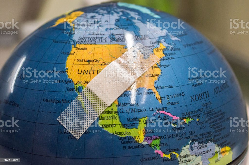 Globe with Bandaid/Plaster Over U.S.A/North America stock photo