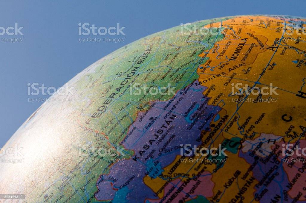 Globe with political division illuminated with sunlight and blue stock photo