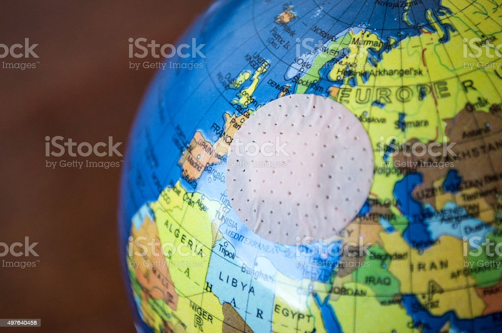 Globe with Small Bandaid/Plaster Over Europe royalty-free stock photo