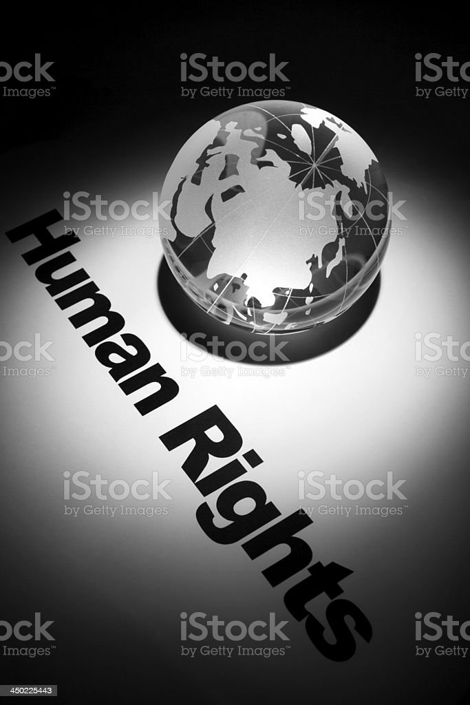 Globe with the word human rights written on the back royalty-free stock photo