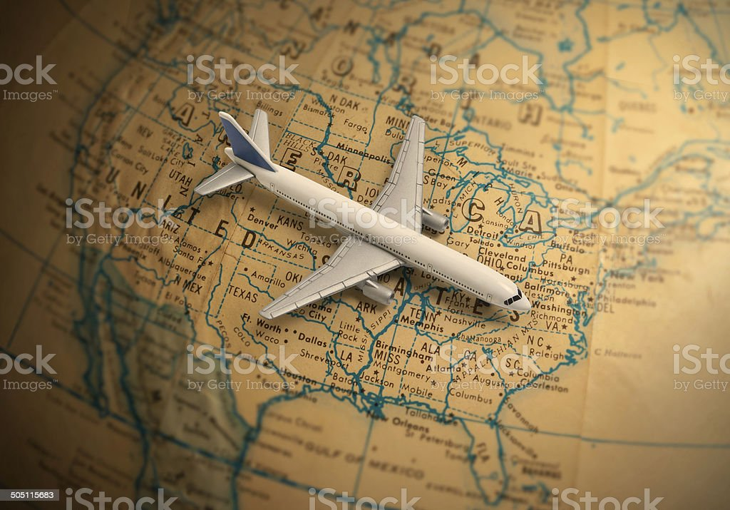 Globetrotting toy jet airliner vacation stock photo