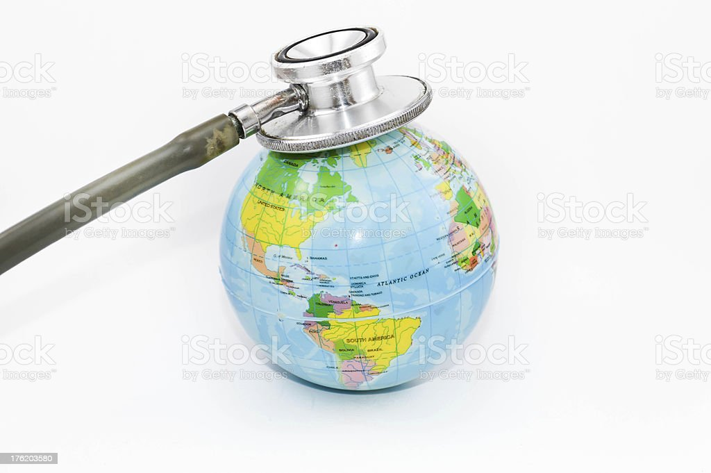 globle health check stethoscope on earth royalty-free stock photo