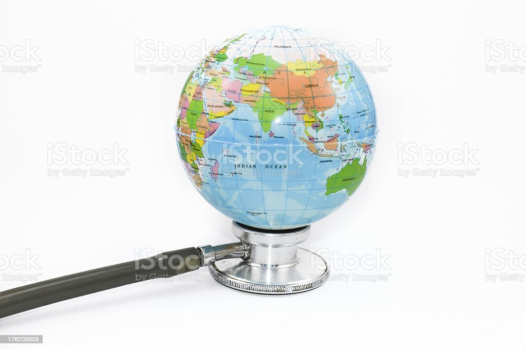 globle health check with stethoscope royalty-free stock photo