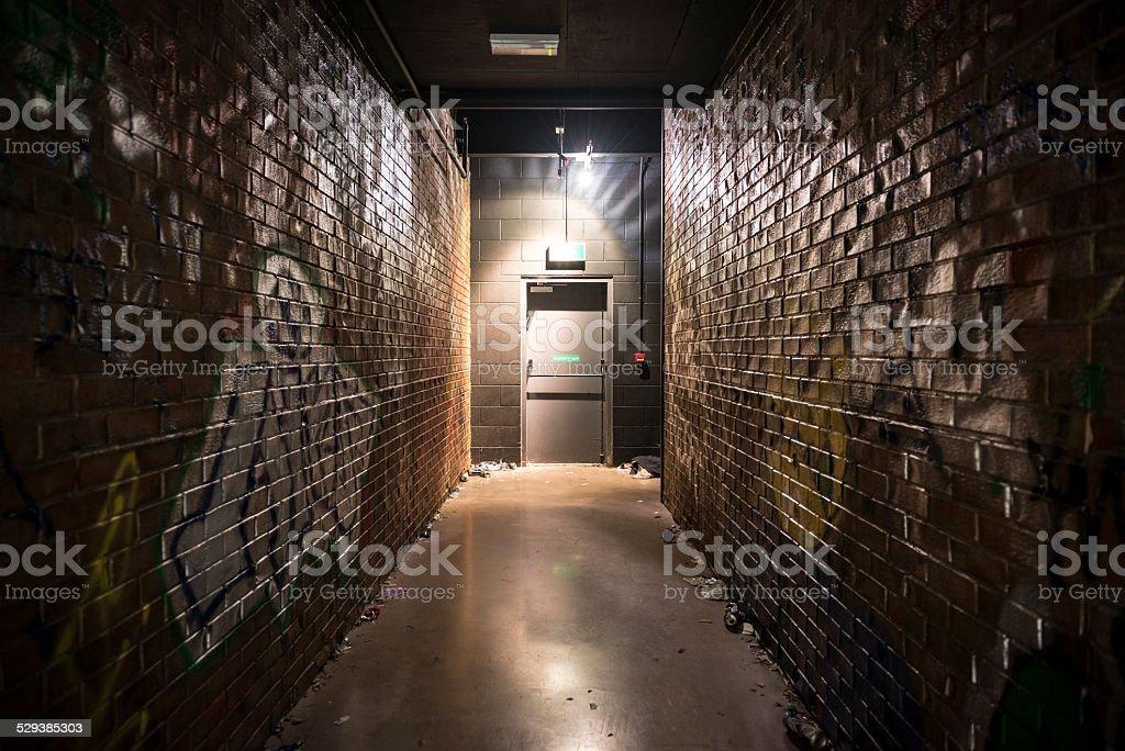 Gloomy dark alley with door stock photo