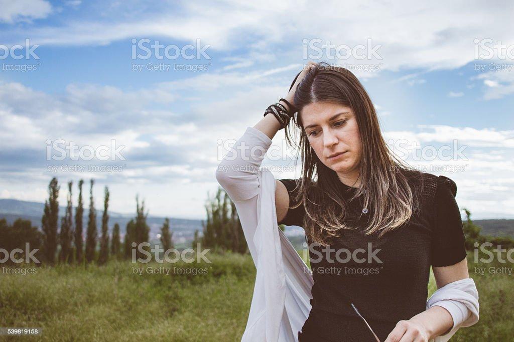 Gloomy girl in the spectacural scenic stock photo